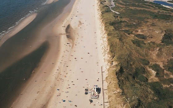 an areal view of bergen aan zee beach
