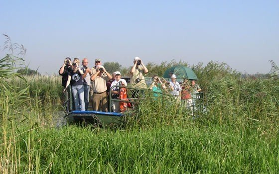 People on a boat at National Park the Biesbosch