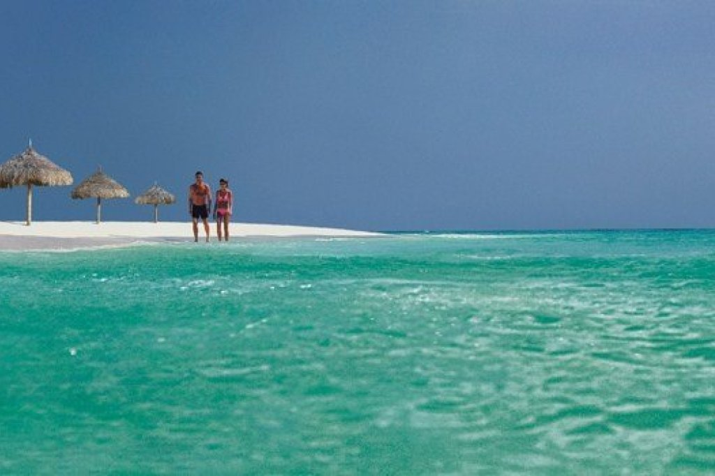 Couple standing on a beach of Aruba