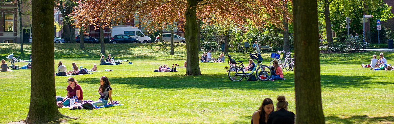 People sitting and have a picnic in a city park in Zwolle