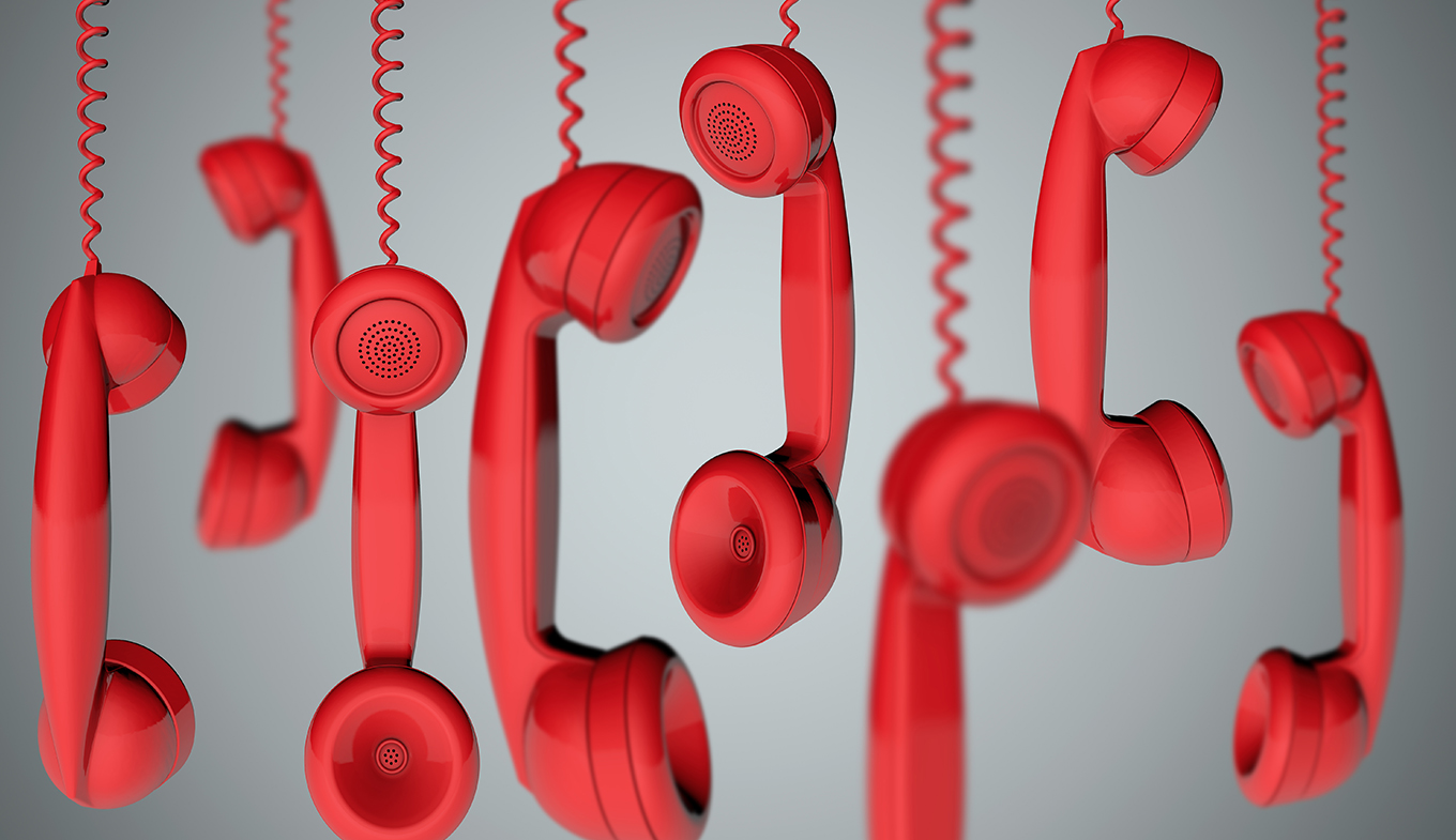 Red hanging telephone receivers