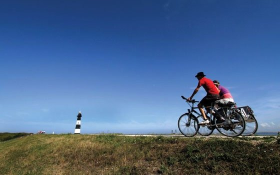 Bicycling in Holland is the best way to see the countryside and get some exercise, too -- but without hills to climb. Photo from Netherlands Board of Tourism.