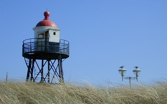 a small tower on the beach near Kijkduin