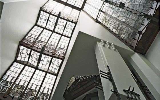 The monumental stairway of the Amrath hotel in the shippinghouse in Amsterdam