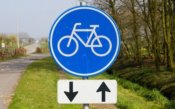 A sign saying there is a bike path for bikes only in two directions
