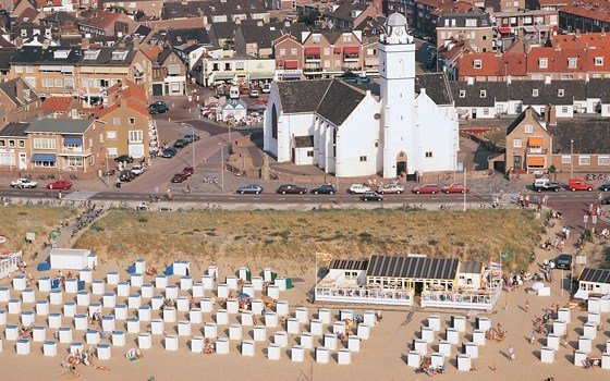 a birds eye view over the church and beach of katwijk