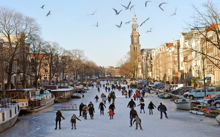 Ice skating on the canals of Amsterdam