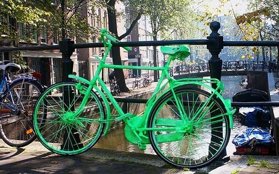 A bright green bike on a canal