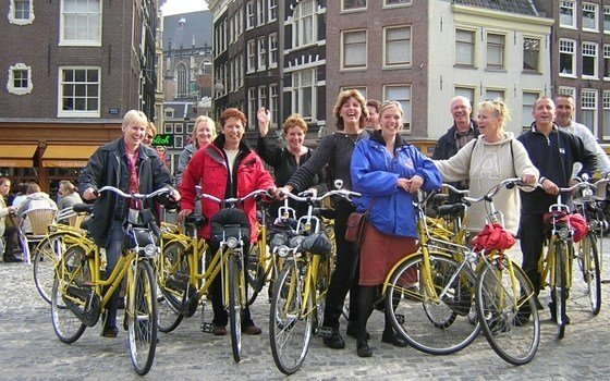 A cycling group of tourists in Amsterdam