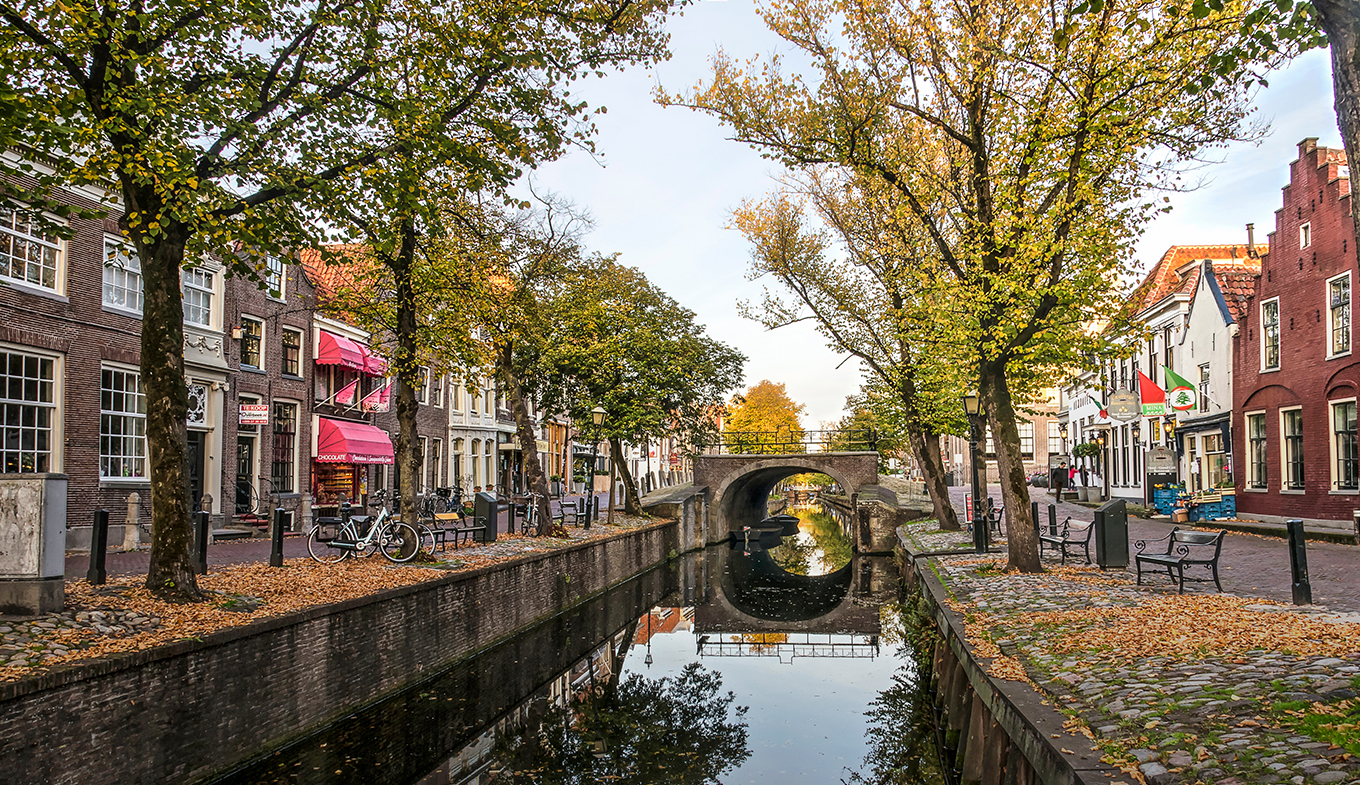 Edam view along canal towards Dam in autumn