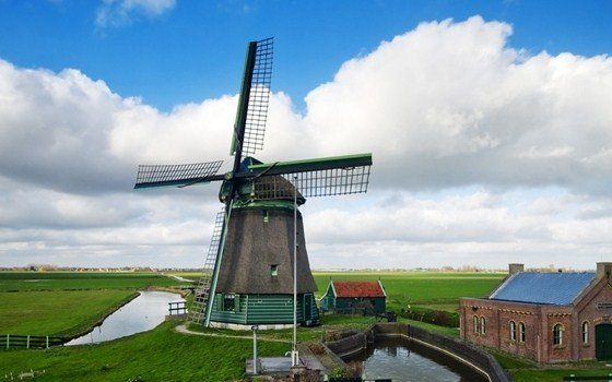 Windmill in Dutch landscape
