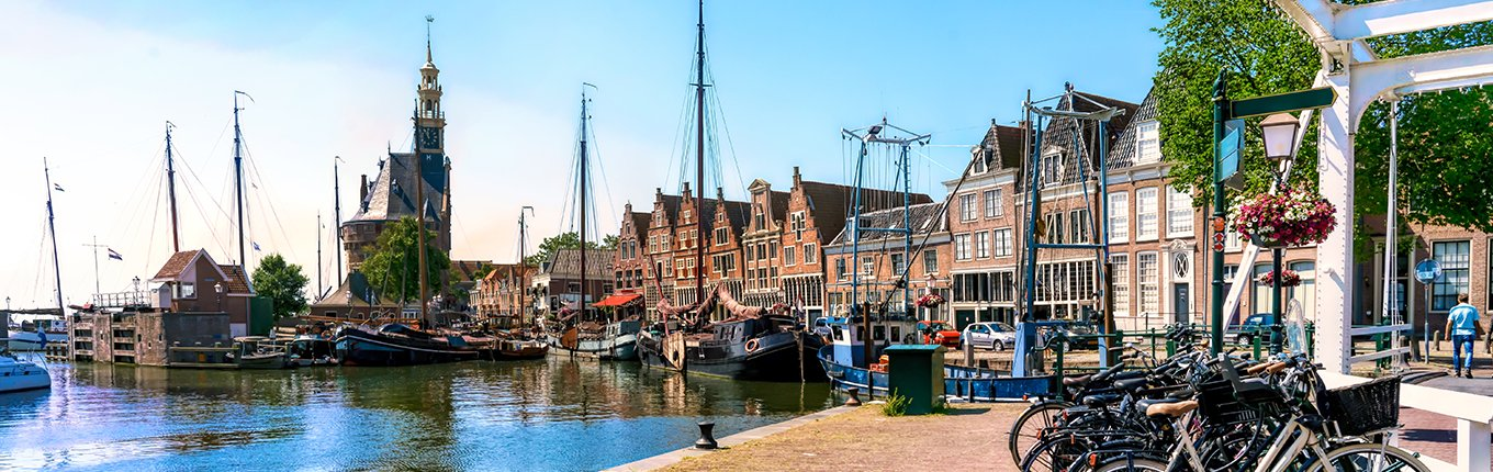 Harbor of Hoorn with the Hoofdtoren, sailboats and city buildings